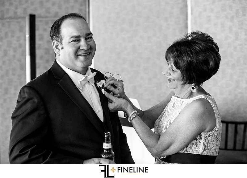 mother of the groom putting on boutonnière