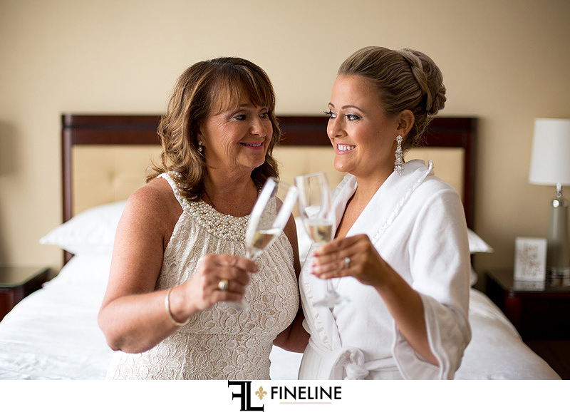 bride and mother drinking champagne