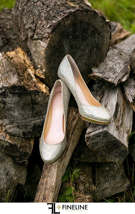 brides shoes on wood