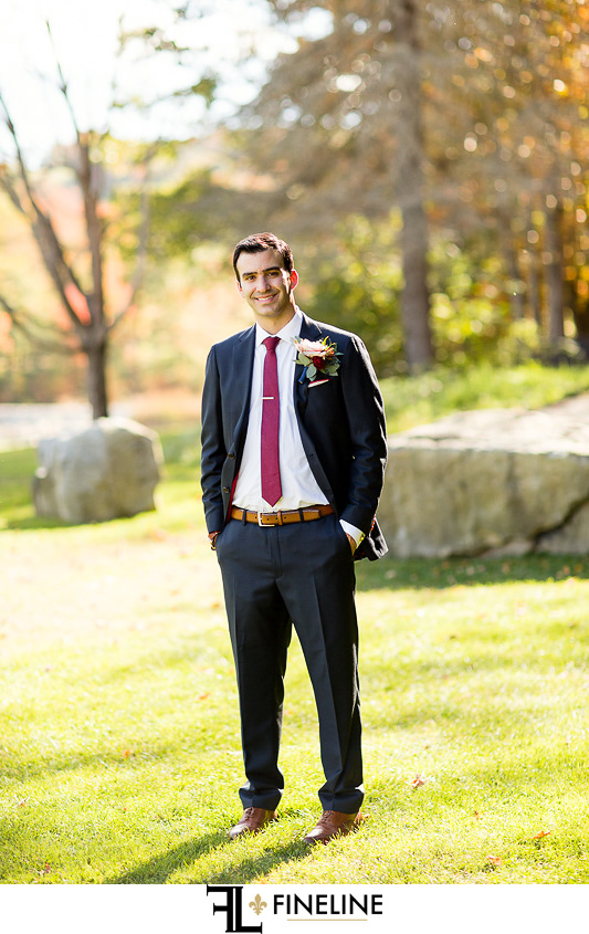 groom with burgundy tie