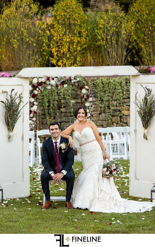 bride and groom with doors