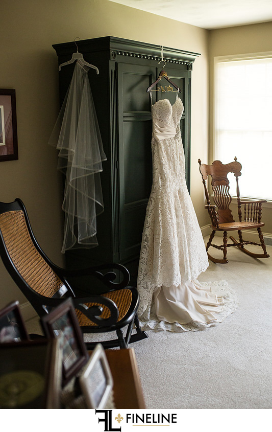 Wedding dress surrounded by antiques