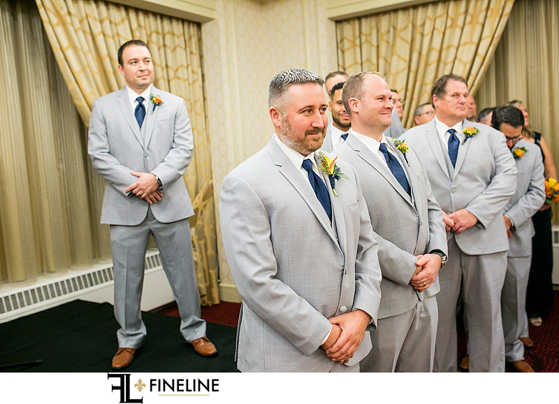 gray suits with blue ties