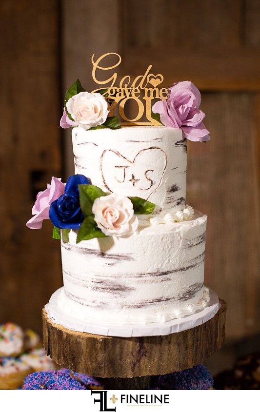 rustic cake with pink blue and white flowers