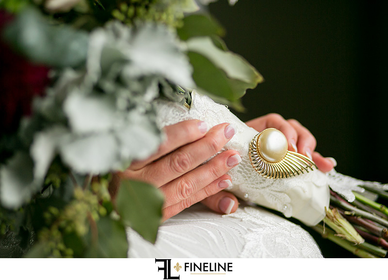 vintage pin on wedding bouquet