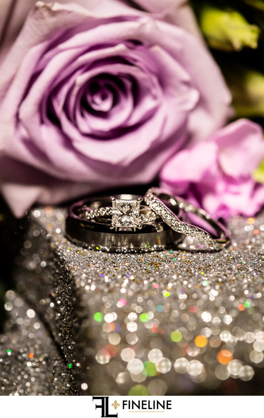 wedding rings and purple flowers