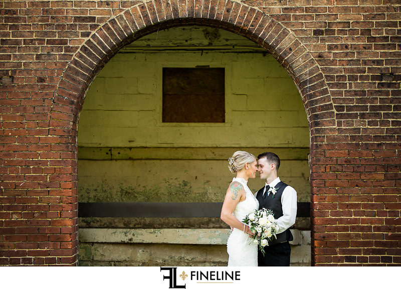 Wedding at West Overton Barn, Scottdale PA FINELINE weddings Greensburgh PA brind and groom under arch