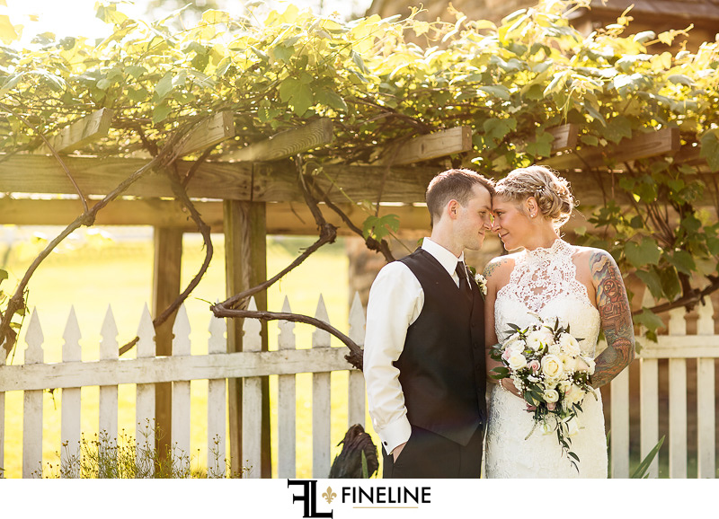 Wedding at West Overton Barn, Scottdale PA FINELINE weddings Greensburgh PA bride and groom white picket fence