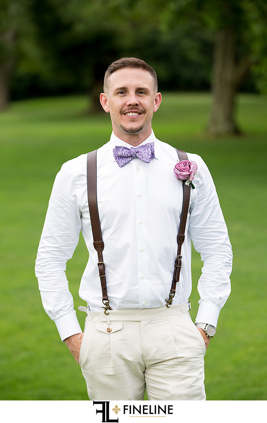 Groom in TOMS and leather suspenders FINELINE weddings Greensburg PA