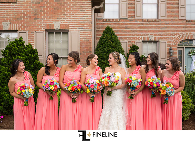 FINELINE weddings photography Greensburg PA bridal party with rainbow bouquets and pink dresses