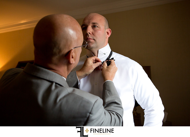groom and dad putting on bow tie