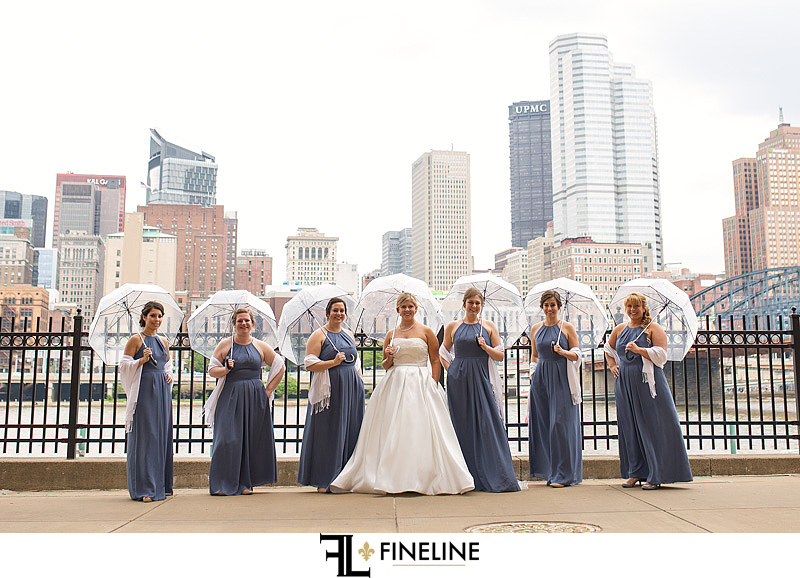 wedding party in the rain Downtown Pittsburgh Wedding photos by FINELINE Weddings Greensburg PA
