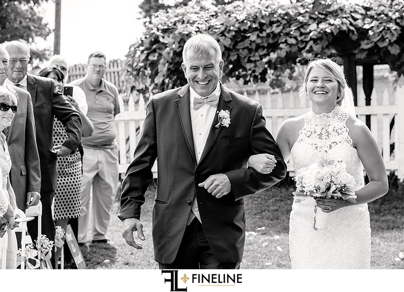 father of the bride walking down the isle