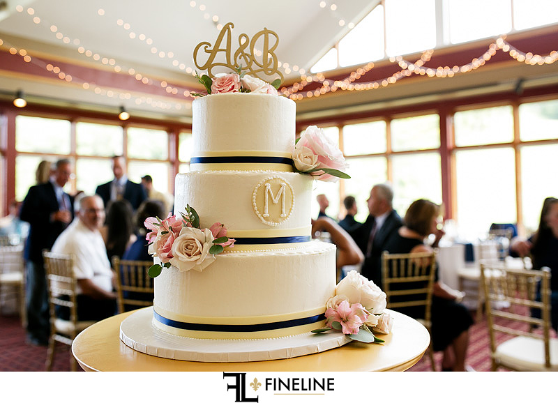 pink, gold and navy blue wedding cake