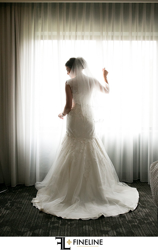 bride at window photo by FINELINE Weddings Greensburg, PA