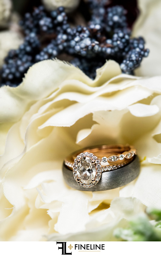 wedding ring and white roses