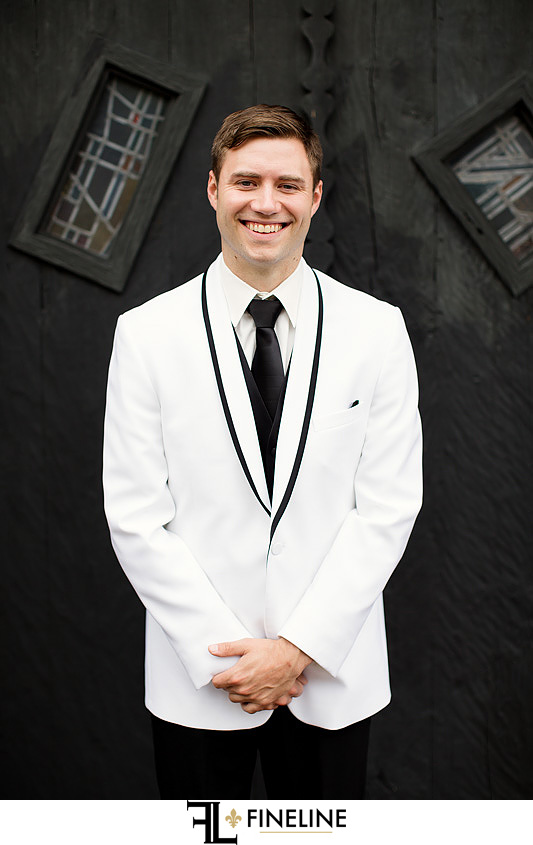 groom in white suit  photo by FINELINE Weddings Greensburg, PA